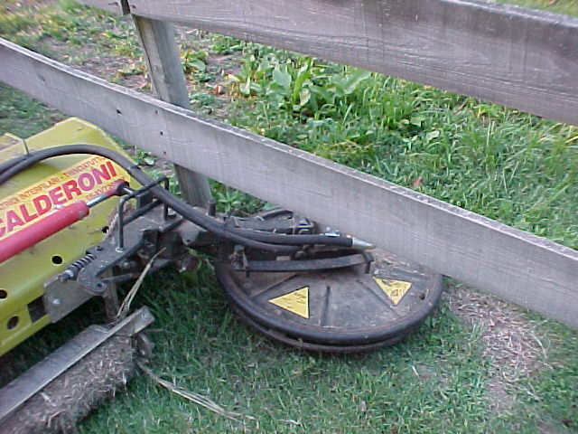mow under fence boards